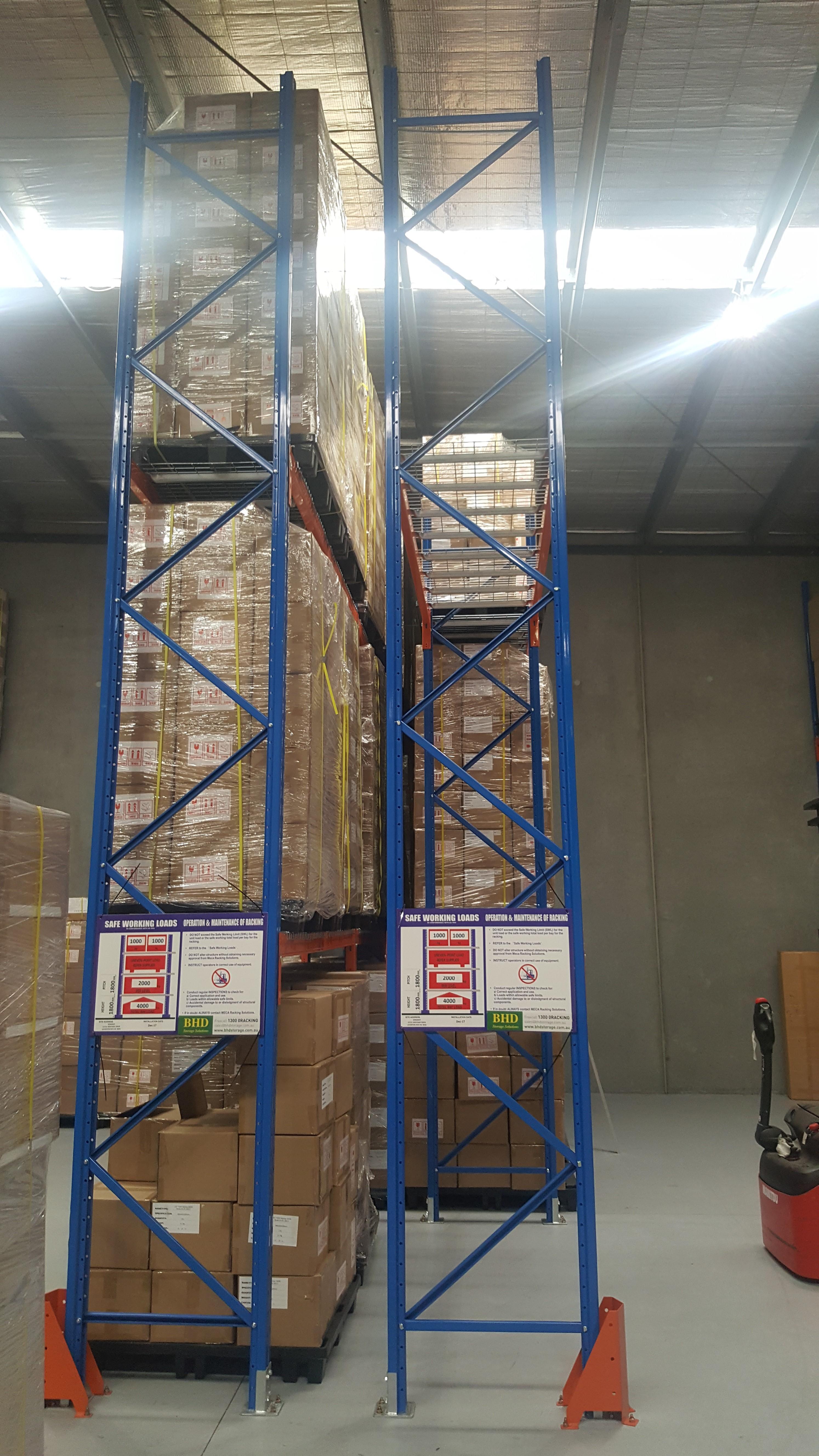 Two Blue goods shelves full of goods