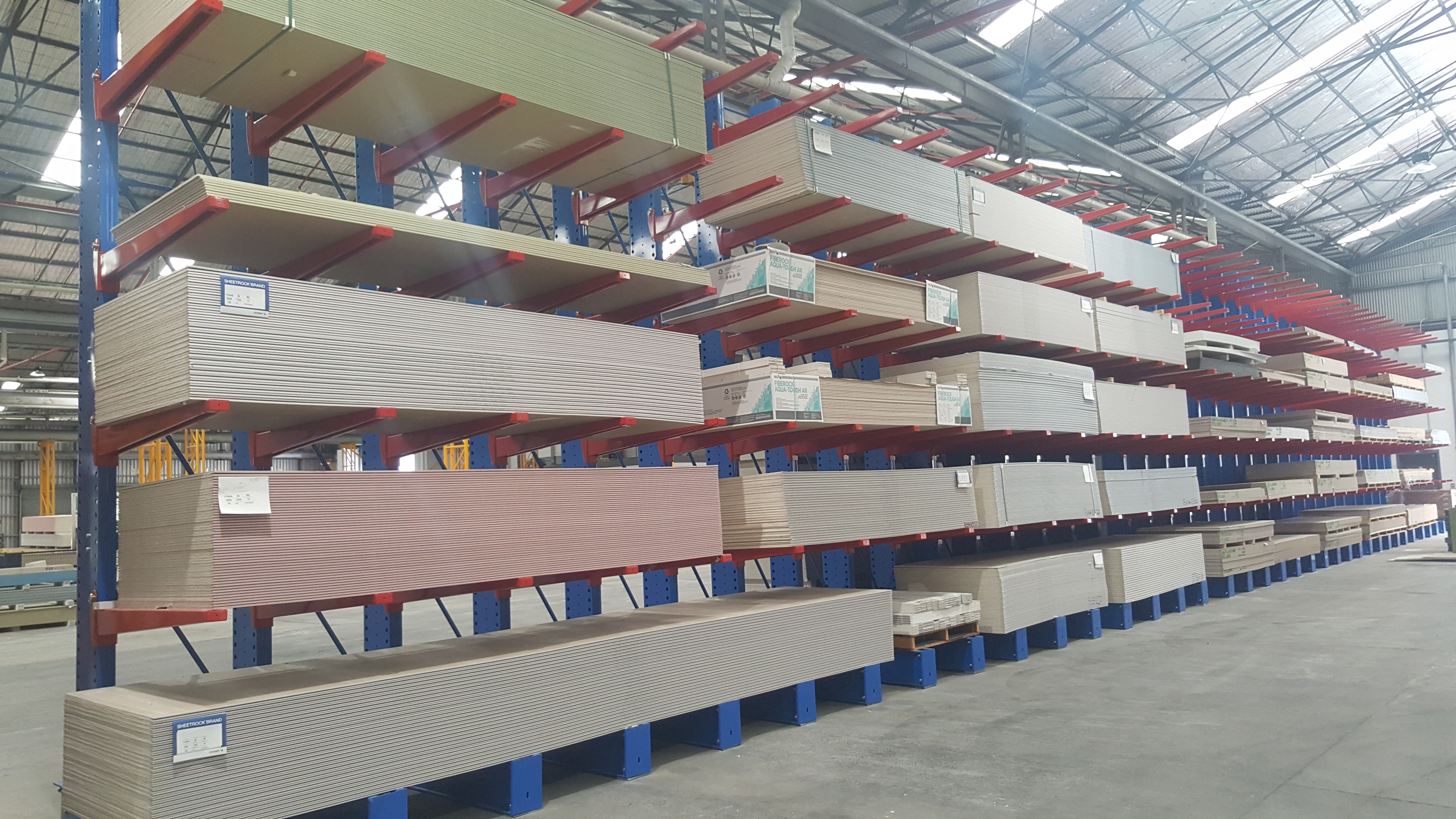 Cantilever Racking storing irregular, awkward and long bulk items such as steel, timber, plasterboard, aluminium and oversized pallets.