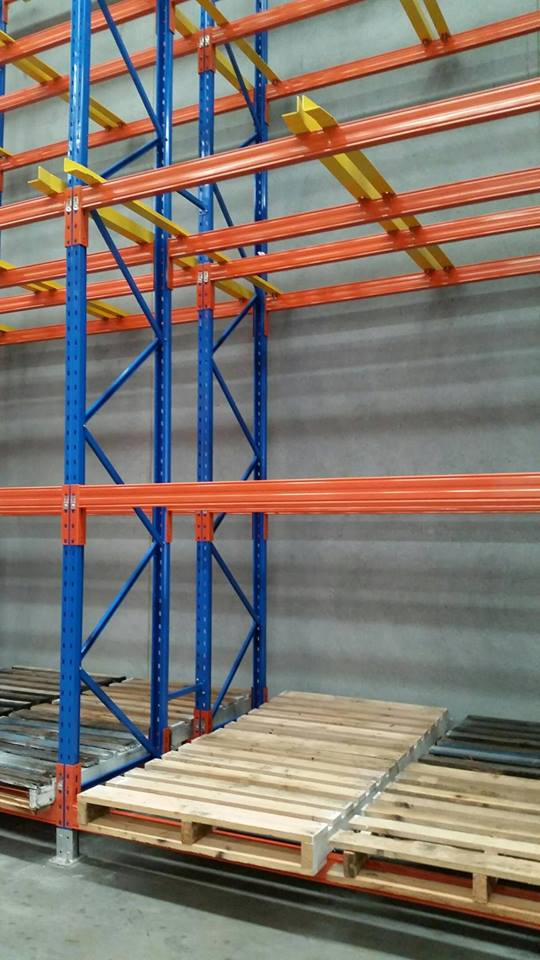 blue and red goods shelf with pallet