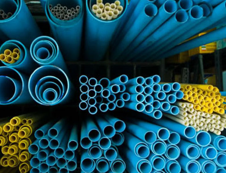 different size of blue,yellow, and white colour plastic pipe