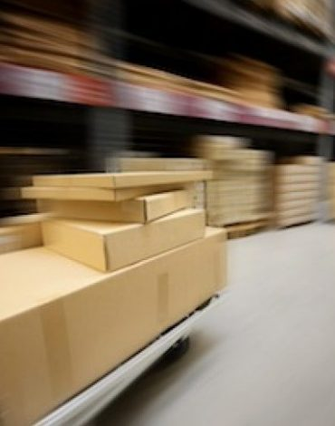 box package goods on cart in warehouse
