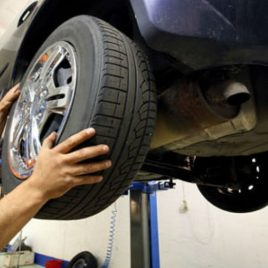 maintaining blue car wheels by using hanging shelf