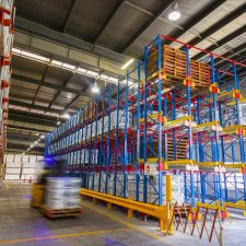 Shuttle Racking storing pallets on rails in a high density warehouse using a shuttle cart to transport pallets in and out of the shuttle racking system.
