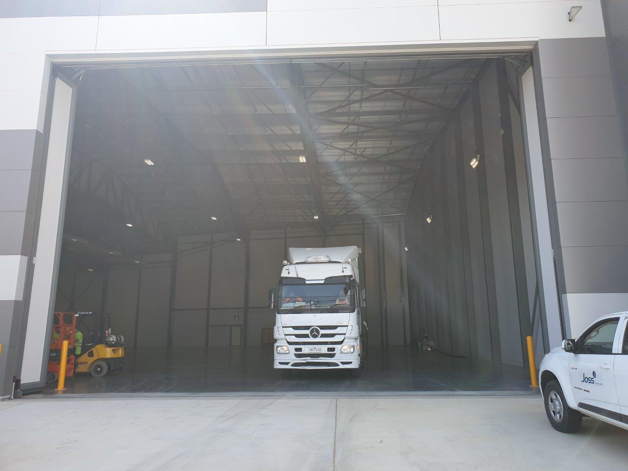 logistics vehicle driving out of the warehouse